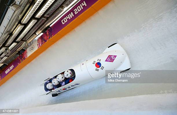 Pilot Donghyun Kim Sik Kim Kyunghyun Kim and Jeahan Oh of Korea team 2 make a run during the Men's Four Man Bobsleigh on day 16 of the Sochi 2014...