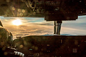 Pilot of commercial aircraft is enjoying stunning sunrise.