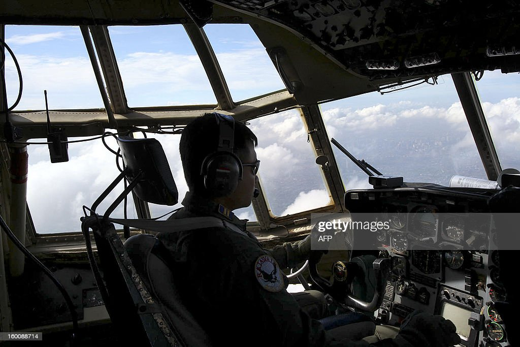 A pilot flies a Hercules plane as he looks for the correct cloud to place sodium chloride for cloud seeding, in flight over West Java on January 26, 2013 as part of their effort to prevent flooding in the capital by using the weather modification techniques. Indonesian authorities will use generators and cloud-seeding measures to defuse and push away rain-laden clouds to avoid more flooding that has paralysed Jakarta, an official said, heavy rain over the mega-city last week caused 32 deaths and at its peak forced nearly 46,000 people to flee their inundated homes, Sutopo Purwo Nugroho, spokesman for the National Disaster Mitigation Agency, added.