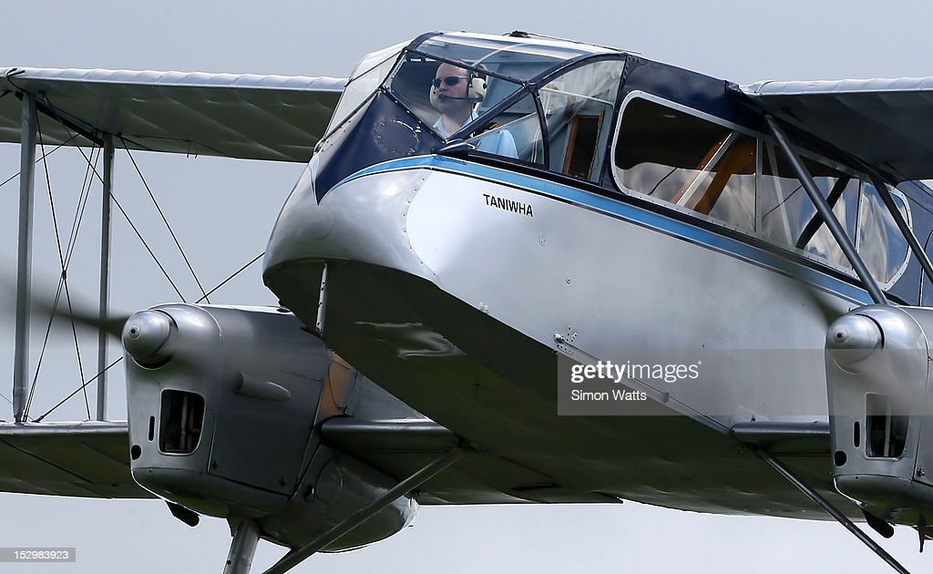 A pilot flies a vintage de Havilland plane during an airshow commemorating the completion of the rebuild of de Havilland Mosquito KA 114, on September 29, 2012 in Ardmore, New Zealand. The plane was restored by Warbird Restorations at Ardmore Aerodrome and is the only flying Mosquito in the world.