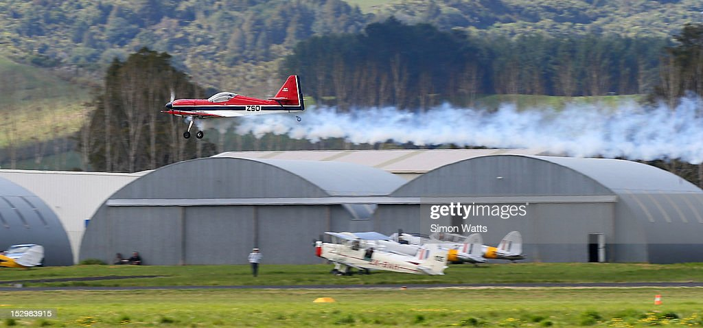 A pilot flies performs aerobatics during an airshow commemorating the completion of the rebuild of de Havilland Mosquito KA 114, on September 29, 2012 in Ardmore, New Zealand. The plane was restored by Warbird Restorations at Ardmore Aerodrome and is the only flying Mosquito in the world.