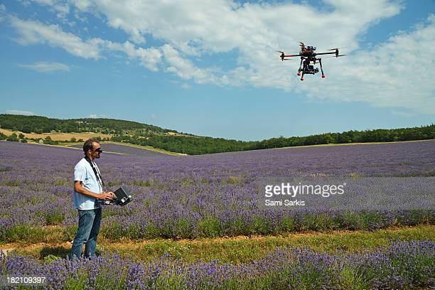 Pilot flying a drone (UAV) to film lavender fields