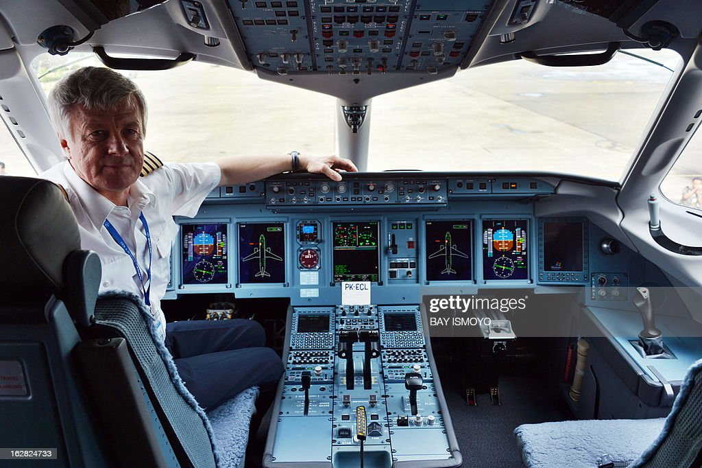 A pilot for Sky aviation's new aircraft the Sukhoi Superjet 100 poses in the cockpit during the launching ceremony at Halim airport in Jakarta on...