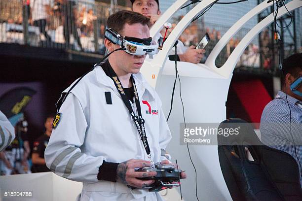 A pilot for the British Team Black Sheep UK flies the team drone during the quarterfinals at the World Drone Prix drone racing championship in Dubai...