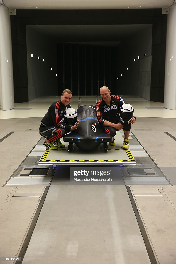 Pilot Francesco Friedrich (L) and Alexander Mann of Team Germany 1 pose with their new Bobsleigh FES 208 in the Wind tunnel of Technology Partner BMW on October 29, 2013 in Munich, Germany.