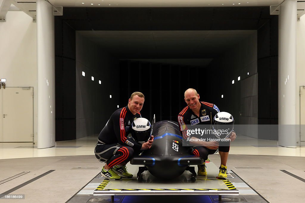Pilot Francesco Friedrich(L) and Alexander Mann of Team Germany 1 pose with their new Bobsleigh FES 208 in the Wind tunnel of Technology Partner BMW on October 29, 2013 in Munich, Germany.