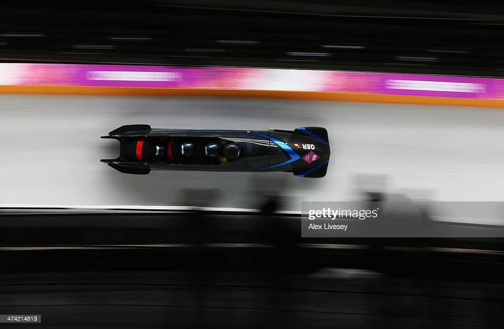 Pilot Francesco Friedrich, Jannis Baecker, Gregor Bermbach and Thorsten Margis of Germany team 2 make a run during the Men's Four Man Bobsleigh heats on Day 15 of the Sochi 2014 Winter Olympics at Sliding Center Sanki on February 22, 2014 in Sochi, Russia.