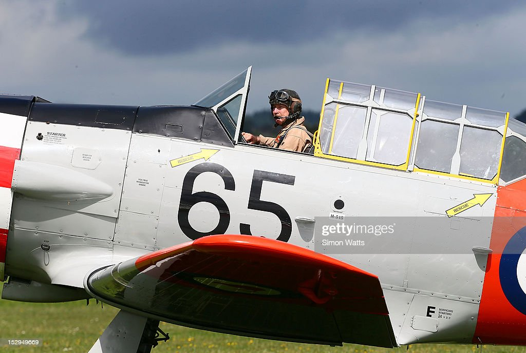 A pilot from the Roaring 40's Harvard display team prepares to take off during an airshow commemorating the rebuild of de Havilland Mosquito KA 114, on September 29, 2012 in Ardmore, New Zealand. The plane was restored by Warbird Restorations at Ardmore Aerodrome and is the only flying Mosquito in the world.