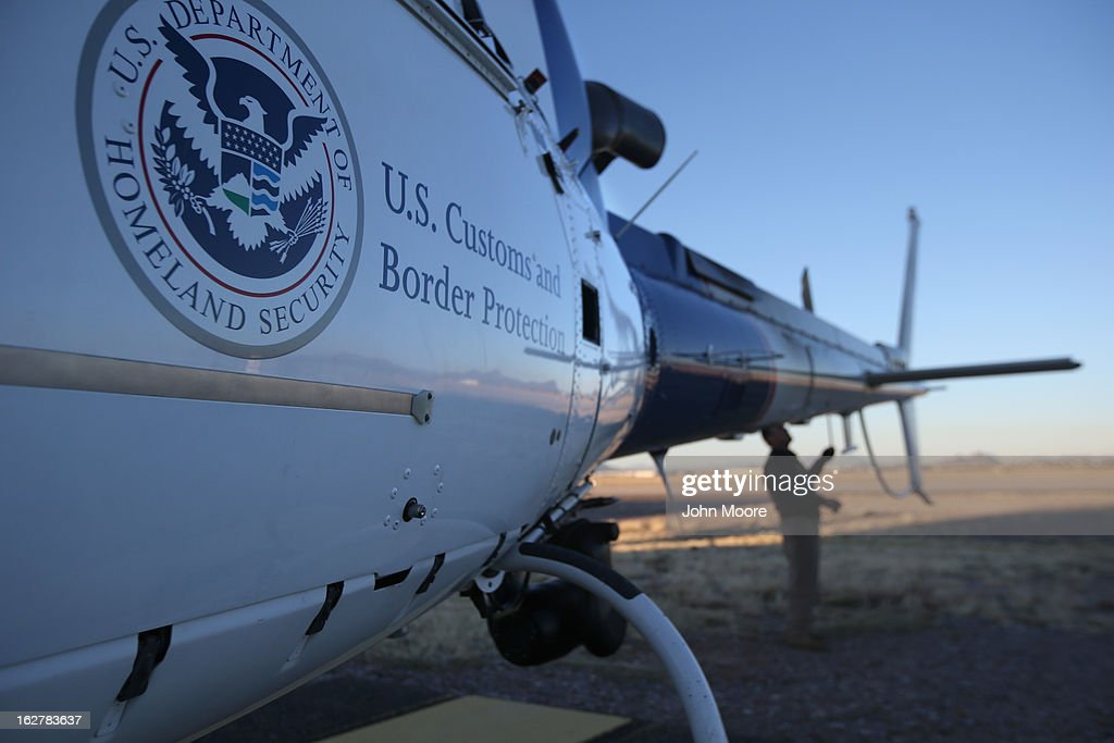 A pilot from the U.S. Office of Air and Marine prepare a helicopter for an aerial patrol on February 26, 2013 in Tucson, Arizona. The U.S. Customs and Border Protection agency flies over the U.S.-Mexico border searching for drug smuglers entering the United States from Mexico.