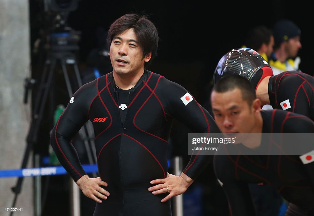 Pilot Hiroshi Suzuki (L) of Japan team 1 looks on after competing during the Men's Four Man Bobsleigh heats on Day 15 of the Sochi 2014 Winter Olympics at Sliding Center Sanki on February 22, 2014 in Sochi, Russia.