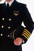 Pilot holding his hat