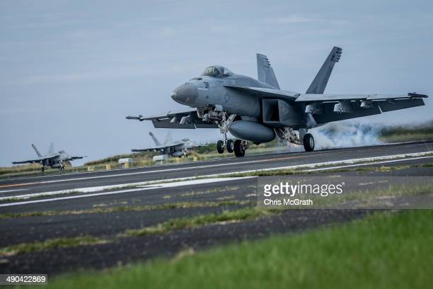 A pilot in a F/A18E Super Hornet completes a touchandgo landing during Field Carrier Landing Practice for the Carrier Air Wing 5 of US Naval Air...
