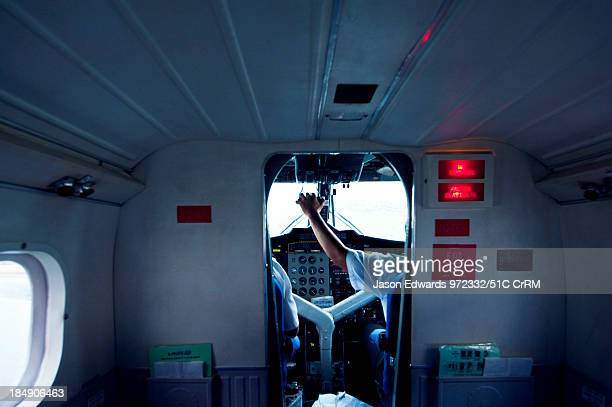 A pilot in the cockpit controls the planes acceleration in takeoff Taveuni Island Pacific Ocean Fiji Islands