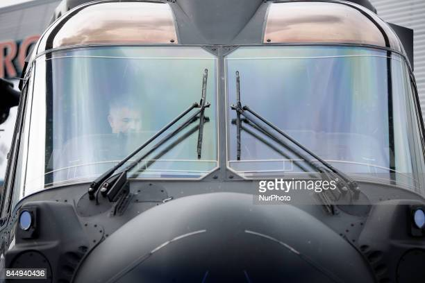 A pilot is seen in the cockpit of a Leonardo AW101 helicopter during the 25th International Defence Industry Exhibition in Kielce Poland on 8...