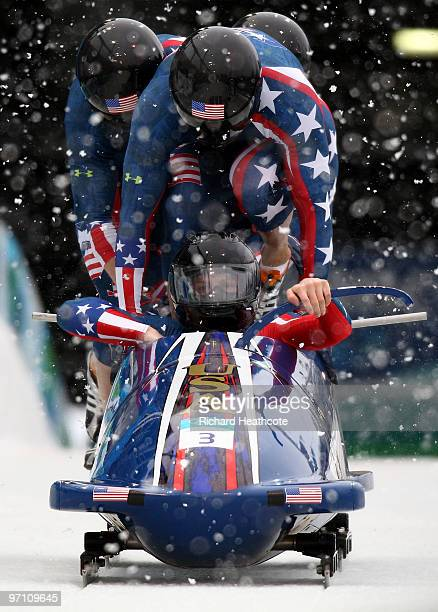 Pilot John Napier Charles Berkeley Steven Langton and Christopher Fogt of the United States compete in USA 2 during the fourman bobsleigh heat 1 on...