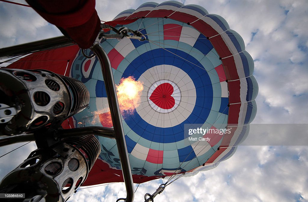 Pilot John Sproat adjusts the burners as hotair balloons begin to rise into the early morning sky during the mass assent at the Bristol International...
