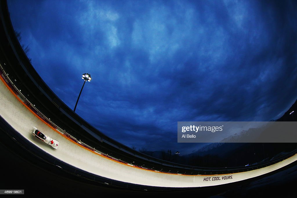 Pilot Justin Kripps and Bryan Barnett of Canada team 3 make a run during the Men's TwoMan Bobsleigh on Day 10 of the Sochi 2014 Winter Olympics at...