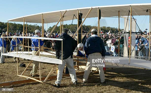 Pilot Kevin Kochersberger test runs a reproduction of the 1903 Wright Flyer December 15 2003 at the Wright Brothers National Memorial in Kill Devil...