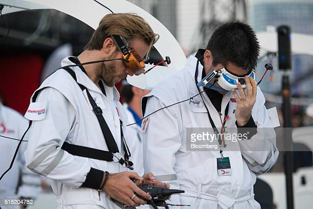 A pilot left and navigator for team Freybott fly their drone during the quarterfinals at the World Drone Prix drone racing championship in Dubai...