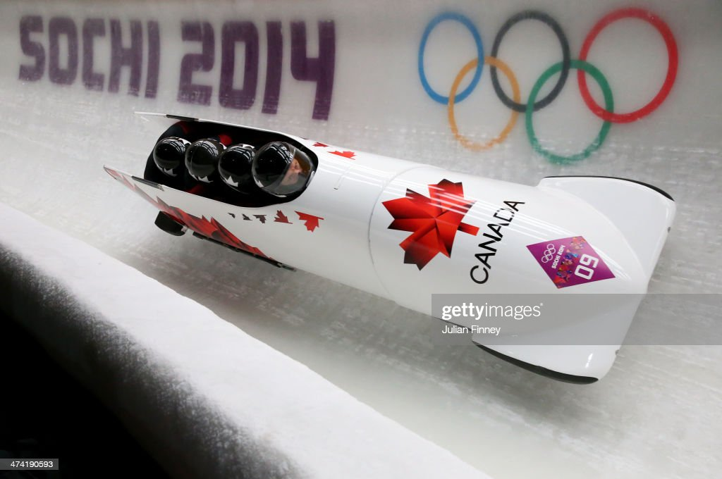 Pilot Lyndon Rush Lascelles Brown David Bissett and Neville Wright of Canada team 2 make a run during the Men's Four Man Bobsleigh heats on Day 15 of...