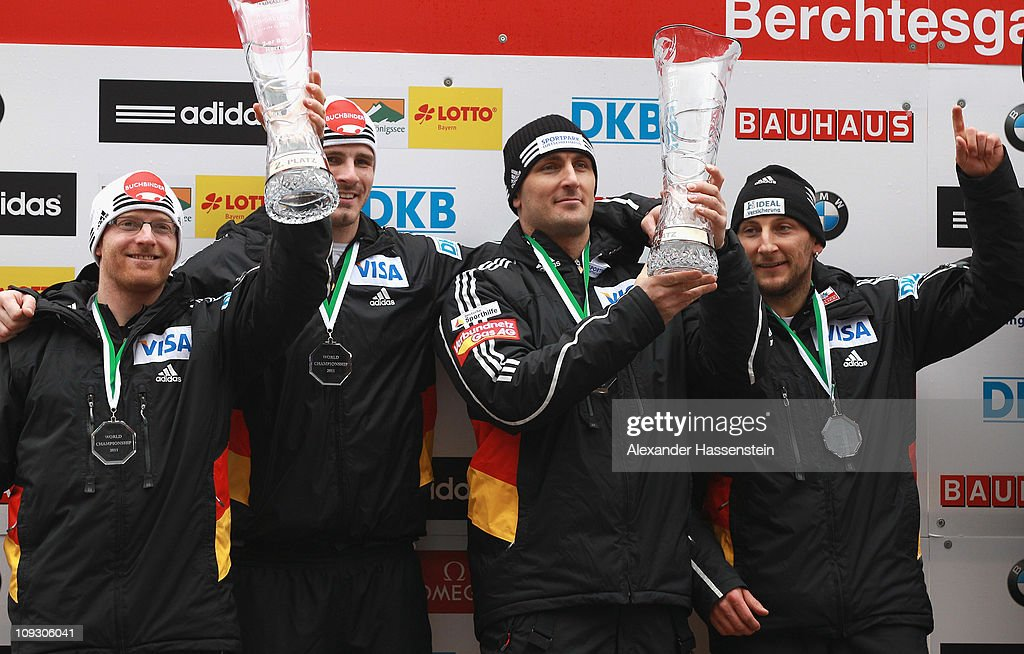 Pilot Manuel Machata (L) and his team mate Andreas Bredau (2nd L) of Team Germany 1 celebrates winning the 2nd place together with Pilot Thomas Florschuetz (R) and <a gi-track='captionPersonalityLinkClicked' href=/galleries/search?phrase=Kevin+Kuske&family=editorial&specificpeople=780181 ng-click='$event.stopPropagation()'>Kevin Kuske</a> (2nd R) of Team Germany 3 after the final run of the men's Bobsleigh World Championship on February 20, 2011 in Koenigssee, Germany.