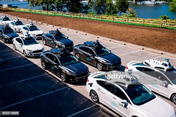 Pilot models of the Uber selfdriving car is displayed at the Uber Advanced Technologies Center on September 13 2016 in Pittsburgh Pennsylvania Uber...