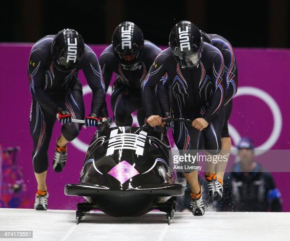 Pilot Nick Cunningham Justin Olsen Johnny Quinn and Dallas Robinson of the United States team 2 make a run during the Men's Four Man Bobsleigh heats...