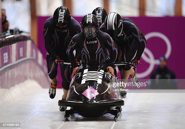Pilot Nick Cunningham Justin Olsen Johnny Quinn and Dallas Robinson of the United States team 2 make a run during the Men's FourMan Bobsleigh on Day...