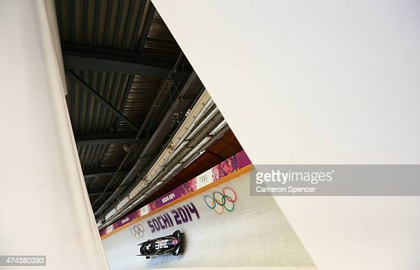 Pilot Nick Cunningham Justin Olsen Johnny Quinn and Dallas Robinson of the United States team 2 make a run during the Men's Four Man Bobsleigh on day...