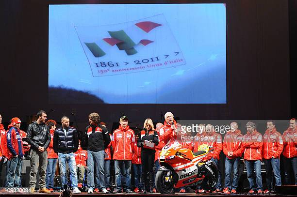 Pilot Nicky Hayden dressed with Red and Blue uniform of Bologna FC of Italian Serie A Football Championship Bologna FC players Emiliano Viviano and...