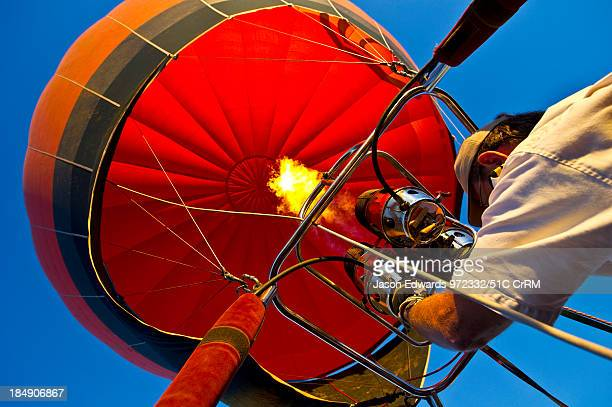 A pilot of a balloon controls altitude using hot air from burning gas Viti Levu Pacific Ocean Fiji Islands