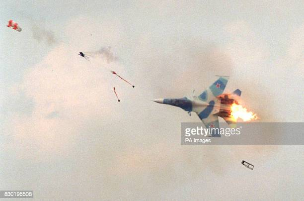 A pilot of a Russianmade Sukhoi30 fighter plane ejects from his plane after it had hit the ground and climbed back in to the sky during a...