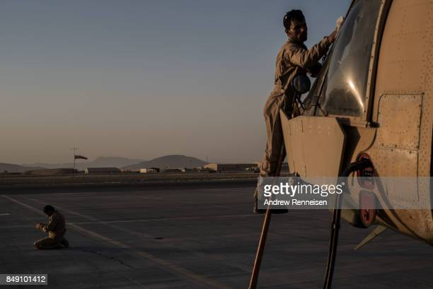 A pilot of the Afghanistan Air Force prays prior to a flight on September 9 2017 at Kandahar Air Field in Kandahar Afghanistan Currently the United...