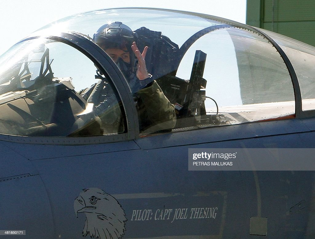 A pilot of US F15C Eagle jet fighter prepares for take off during the Lithuanian NATO air force exercise at the air force base near Siauliai Zuokniai...