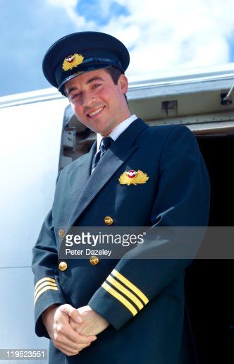 Pilot on steps of plane : Stock Photo