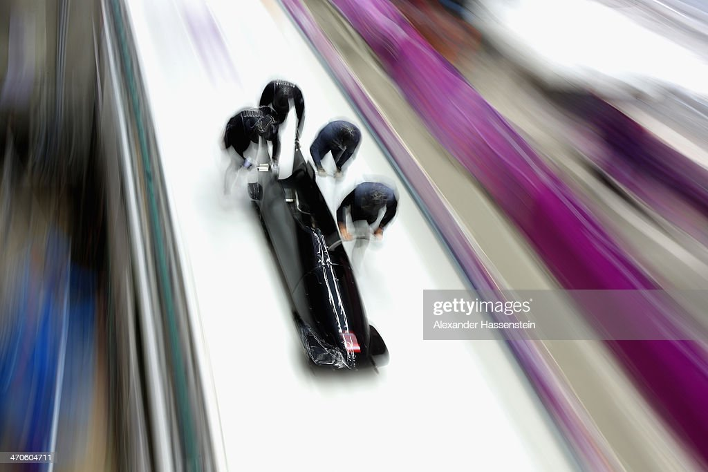 Pilot Oskar Melbardis of Latvia starts with his crew a fourman bobsleigh practice session on Day 13 of the Sochi 2014 Winter Olympics at Sliding...