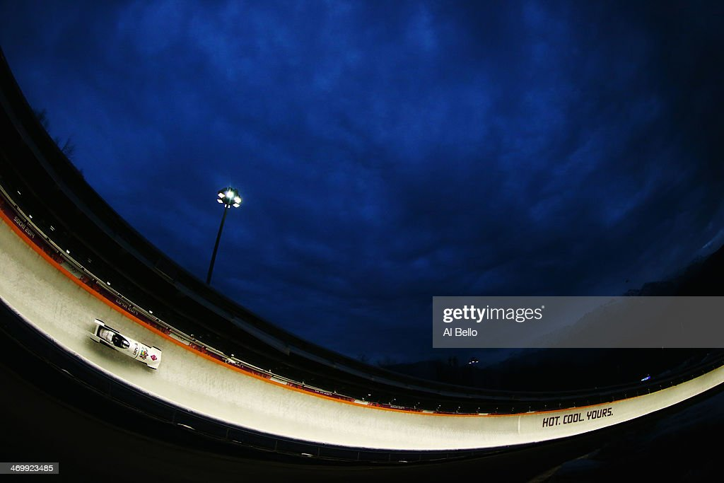 Pilot Oskars Melbardis and Daumants Dreiskens of Latvia team 1 make a run during the Men's TwoMan Bobsleigh on Day 10 of the Sochi 2014 Winter...