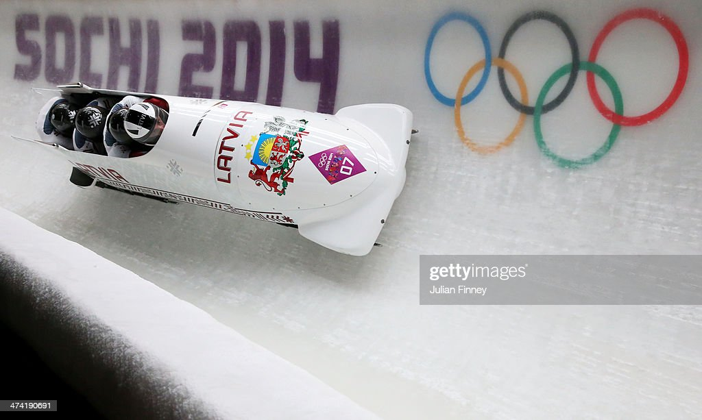 Pilot Oskars Melbardis, Daumants Dreiskens, Arvis Vilkaste and Janis Strenga of Latvia team 1 make a run during the Men's Four Man Bobsleigh heats on Day 15 of the Sochi 2014 Winter Olympics at Sliding Center Sanki on February 22, 2014 in Sochi, Russia.