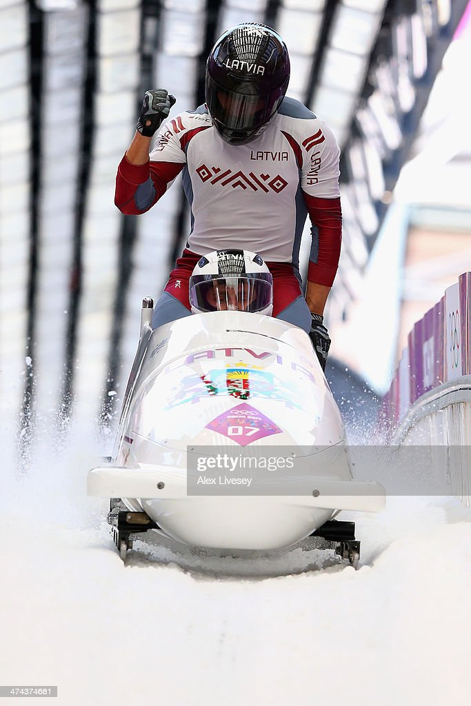 Pilot Oskars Melbardis, Daumants Dreiskens, Arvis Vilkaste and Janis Strenga of Latvia team 1 react after the final run during the Men's Four-Man Bobsleigh on Day 16 of the Sochi 2014 Winter Olympics at Sliding Center Sanki on February 23, 2014 in Sochi, Russia.
