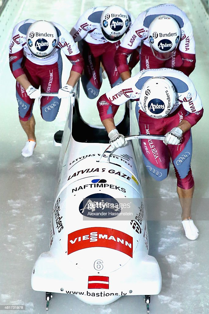Pilot Oskars Melbardis of Latvia competes with Daumants Dreiskens, Arvis Vilkaste and Janis Strenga during the Viessmann FIBT Bob World Cup at Deutsche Post Eisarena on January 18, 2015 in Koenigssee, Germany.