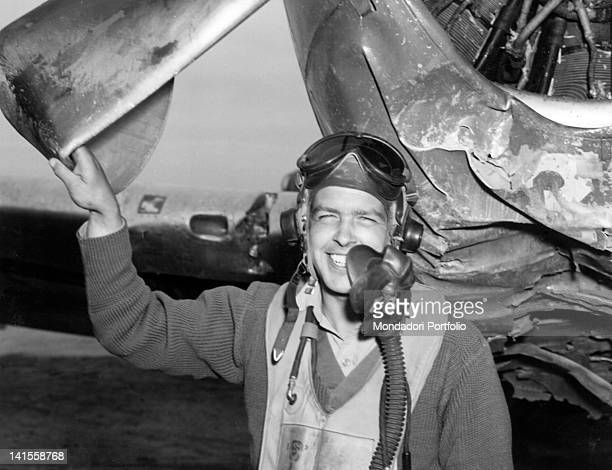 US pilot Paolo Mall posing near his damaged plane in a base of the 12th Allied Air Division Italy November 1944