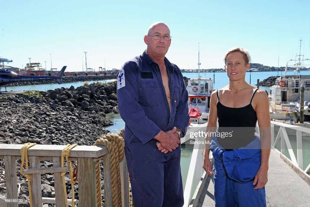 Pilot Peter Maloney (L) and engineer Nina Heatley pose after being rescued from Waitemata Harbour after a helicopter crash on May 7, 2013 in Auckland, New Zealand. Both the pilot and a crew member - the only two on board walked away unscathed after their helicopter crashed into Waitemata Harbour in Auckland today. The two were resuced by the navy after the helicopter reportedly lost power and plummeted into the sea.