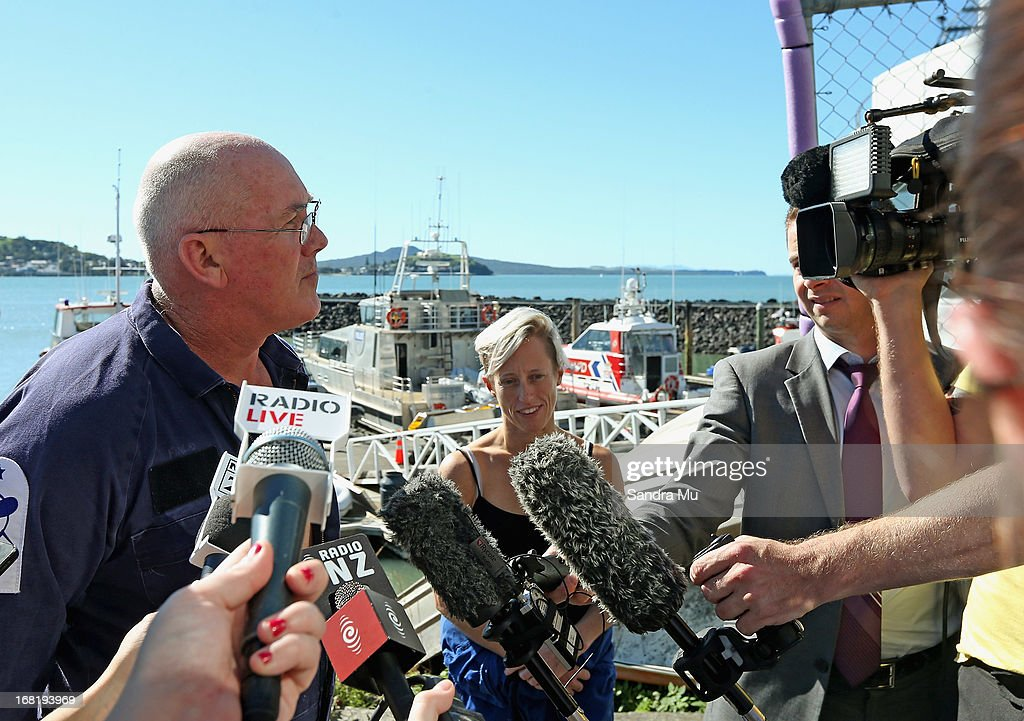 Pilot Peter Maloney and engineer Nina Heatley (R) speak to media after being rescued from Waitemata Harbour after a helicopter crash on May 7, 2013 in Auckland, New Zealand. Both the pilot and a crew member - the only two on board walked away unscathed after their helicopter crashed into Waitemata Harbour in Auckland today. The two were resuced by the navy after the helicopter reportedly lost power and plummeted into the sea.