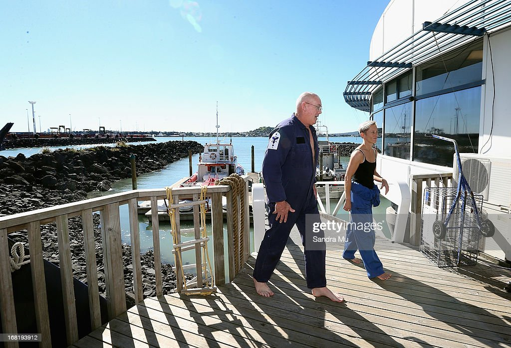 Pilot Peter Maloney (L) and engineer Nina Heatley walk back to base after speaking to media following their rescue from Waitemata Harbour after a helicopter crash on May 7, 2013 in Auckland, New Zealand. Both the pilot and a crew member - the only two on board walked away unscathed after their helicopter crashed into Waitemata Harbour in Auckland today. The two were resuced by the navy after the helicopter reportedly lost power and plummeted into the sea.