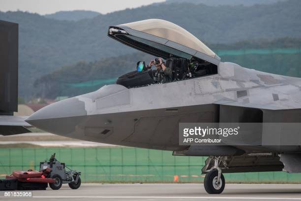 A pilot prepares to perform a display flight in a US Lockheed Martin F22 Raptor stealth fighter aircraft at the Seoul International Aerospace and...