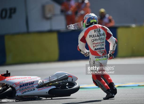 A pilot runs after falling during the French motorcycling Grand Prix on May 21 2017 in Le Mans northwestern France SOUVANT
