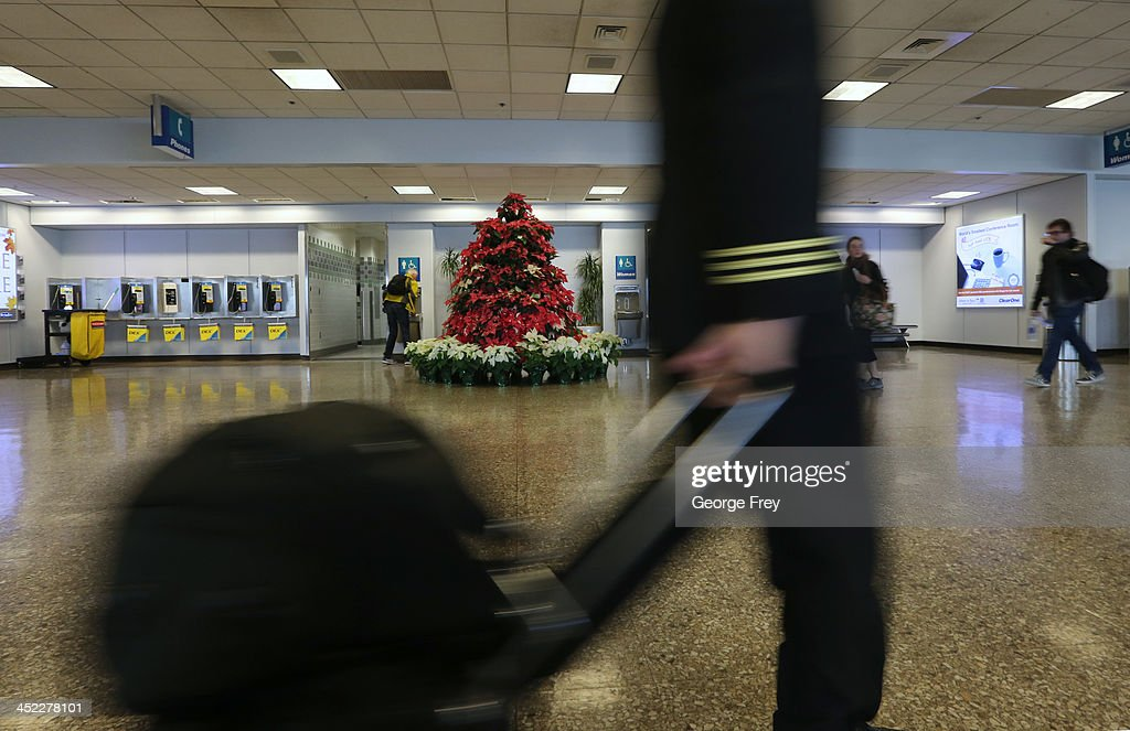 A pilot rushes to his plane at the Salt Lake City international Airport on November 27, 2013 in Salt Lake City, Utah. A wintry storm system that is covering much of the nation is threatening to wreak havoc on holiday travel .