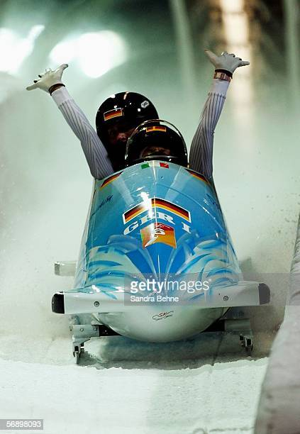 Pilot Sandra Kiriasis and Anja Schneiderheinze of Germany 1 celebrate after winning the gold in the Two Woman Bobsleigh Final on Day 11 of the 2006...