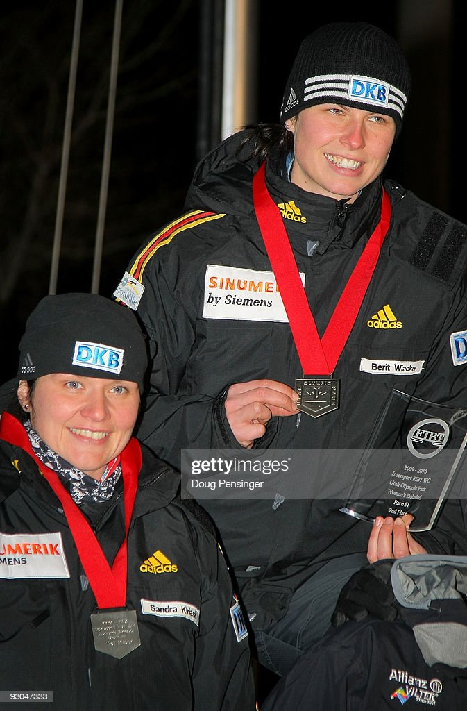 Pilot Sandra Kiriasis and brakeman Berit Wiacker of Germany take the podium after they won the silver medal in the FIBT Women's Bobsled World Cup...