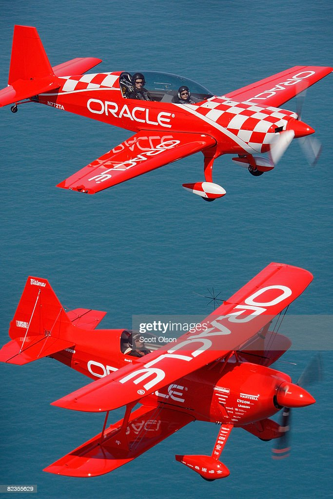 Pilot Sean Tucker (bottom) and his son Eric fly their aircraft over Lake Michigan as they prepare for this weekend's Chicago Air and Water Show August 14, 2008 in Chicago, Illinois. Tucker, his son along with Ben Freelove and Bill Stein will perform as the Collaborators formation aerobatic team during the show.
